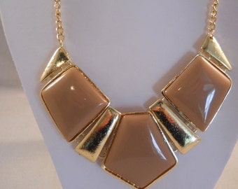 Bib Necklace with Beige and Gold Pendants on a Gold Chain