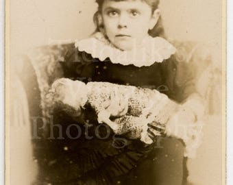 CDV Carte de Visite Photo - Young Victorian Girl, Wide Eyed Holding Toy Doll - South Kensington Studio London England - Antique Photograph