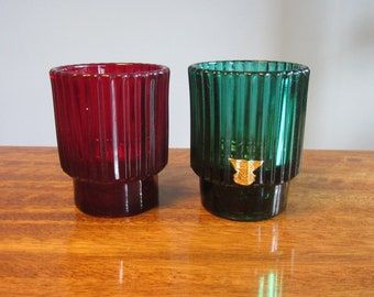 """KJELL BLOMBERG -  Set of two Gullaskruf glass Candle Holders, pattern """"Reffla"""" - One ruby red, one forest green - Made in Sweden - 1960s"""