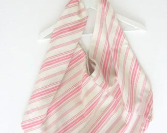 Big carrier bag origami with stripes pink and cream.