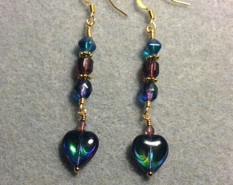 Metallic blue purple Czech glass heart dangle earrings adorned with blue and purple Czech glass beads.