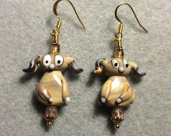 Opaque tan and black lampwork floppy eared puppy dog bead earrings adorned with tan Czech glass beads.