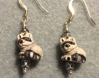 Small black and gray ceramic raccoon bead earrings adorned with gray Chinese crystal beads.