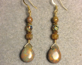 Gold Picasso Czech glass pear drop dangle earrings adorned with gold Picasso Czech glass beads.