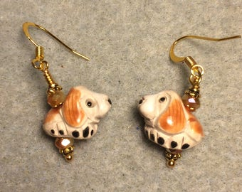 Small tan and beige ceramic hound bead earrings adorned with tan Chinese crystal beads.