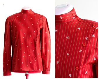 Red long sleeve striped blouse with band collar and off center button closure