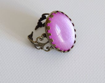 Ring bronze filigree with pink tone glass cabochon