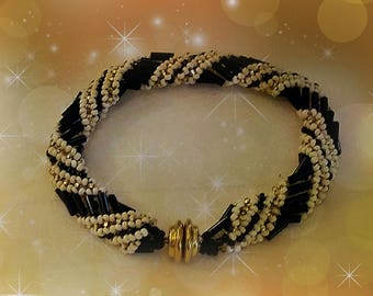 Black, white and gold Russian spiral bracelet.