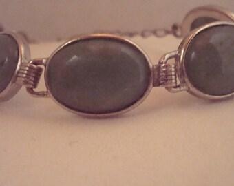Vintage silvertone bracelet with green stone inserts