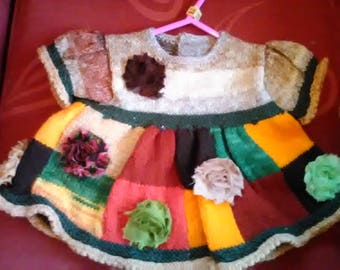 Hand knitted dress to fit a little girl aged 6-12 months old
