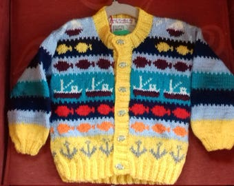 Hand knitted cardigan to fit a child aged 12-18 months old