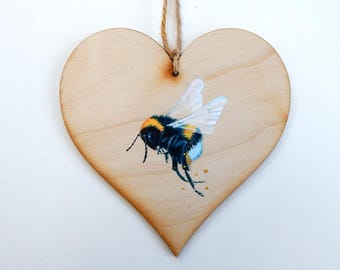 Bumble bee on a wooden heart
