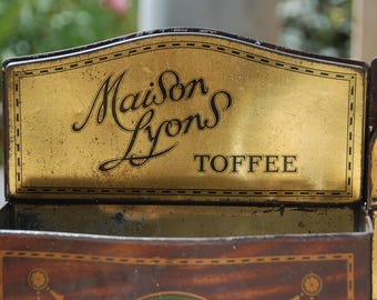 Set of 2 Maison Lyons tin toffee boxes, in the shape of antique candle boxes to hang on the wall. Painted tole, faux bois