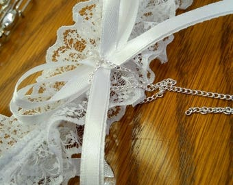 Wedding garter white lace trimmed with white satin ribbon bows