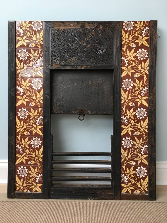 Barnard Bishop & Barnard Ltd, Norwich. A cast iron fire insert designed by Thomas Jeckyll, of Aesthetic design, inset with tiles.