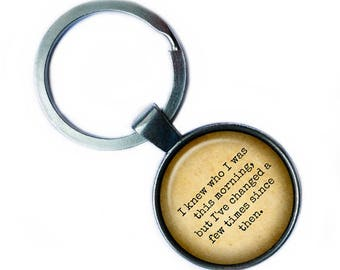 """Alice in Wonderland """"I knew who I was this morning but I've changed a few times since then."""" Keychain Keyring"""