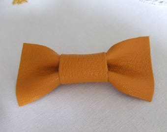 Yellow leather knot brooch