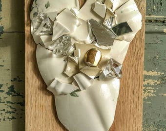 Broken and beautiful white heart wall hanging.