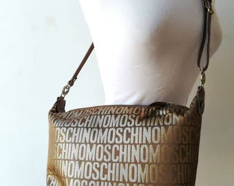 Moschino, bag in fabric and leather bag.