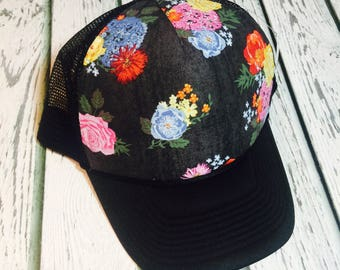 Best selling deep gray floral design trucker hat available in a variety of different brim colors and sizes!
