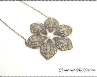 Necklace with pendant filigree brass flower and applique in white resin