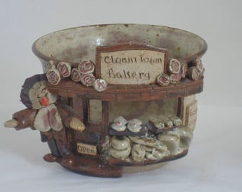 Studio pottery planter or tea light holder. Clown Town Bakery planter decorated as a bakers shop
