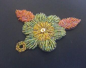 Embroidered orange flower