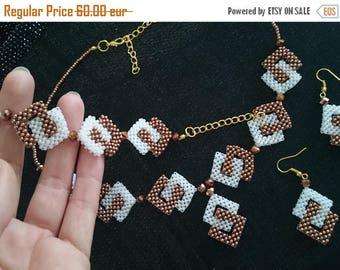 Necklace, bangle, earrings