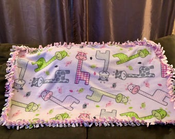 Keep your baby snuggled and warm with this fleece blanket