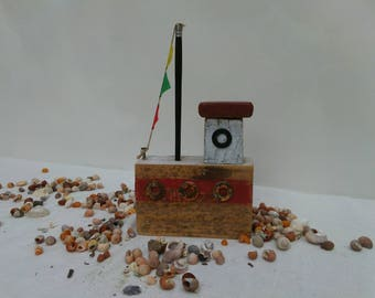 Driftwood, red and white wooden fishing boat.