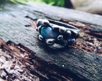 Beautiful magical ring with opal stone. Original design. Modern style. Magic averter. Amulet.
