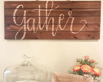 Gather wood plank sign
