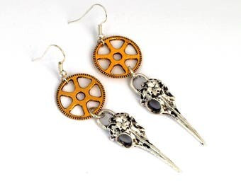 Earrings steampunk gear and headed bird skull skeleton gold and silver
