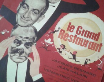 A movie poster for an international 70s Gaumont film from the movie the great Louis Bernard blier funes restaurant
