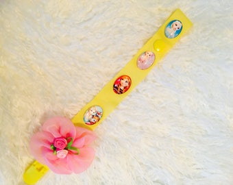 BOUTIQUE Style Anna and Elsa, flower pacifier , yellow Pacifier clips