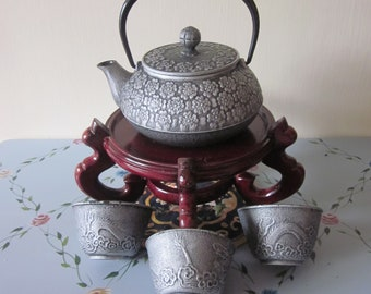 Japanese Cast Iron Teapot with strainer  Holds 25 oz 3 Dragon pattern cast iron Tea cups  All item Have Japan Markings  Very Nice Use set