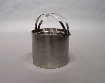 Ice bucket designed by Arne Jacobsen for Stelton.