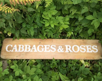 Distressed vintage Cabbages and Roses sign made from distressed pine with white lettering