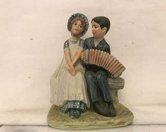 Vintage Young Couple on a Bench Scuplture