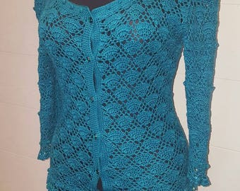 Turquoise crocheted silk costum, designer work.