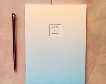 Peach and sky blue fade-out lined notebook