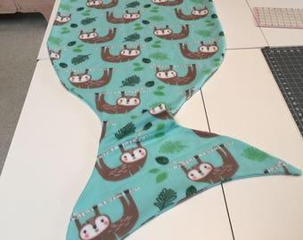 ShellyTails Fleece Mermaid Tail Sleeping Bag Style Blanket in a Teal Sloth Print