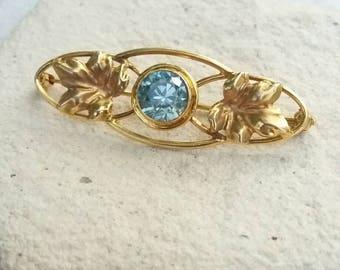 Antique Art Deco 1930s 10k yellow gold/rose gold bezel set natural vivid blue zircon brooch bar pin with ivy vine detail