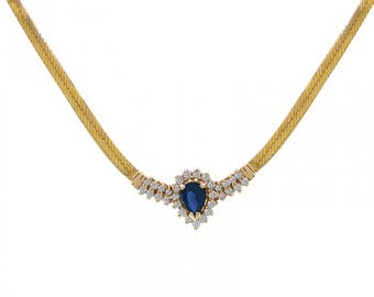 0.60 Carat Pear Cut Sapphire Necklace With 0.31 Carat Round Cut Diamonds 14K Yellow Gold
