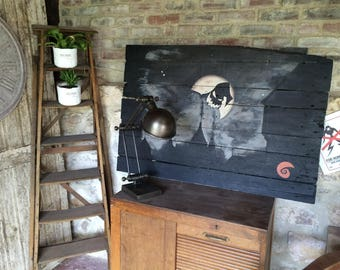 Animation character black and white on reclaimed pallet wood painting