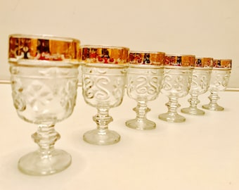 Vintage glasses. Nice for aperitif or port. Rare and in perfect condition. Gold  completely in tact. Facet glass.