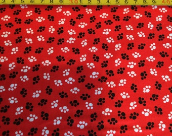 Wilmington Prints Paw Prints, red, black, white by the half yard