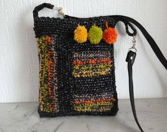 Bag from recycled plastic bags, majority black rays vert/jaune/orange/beige,pompons.fait handmade upcycling