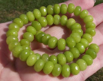 4 BEADS A FACETED PERIDOT 8 X 5 MM.