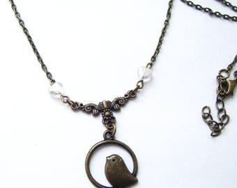 Bronze pattern bird and heart glass pendant